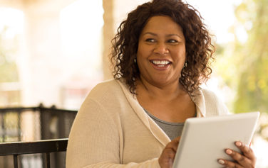 woman-smiling-holding-tablet
